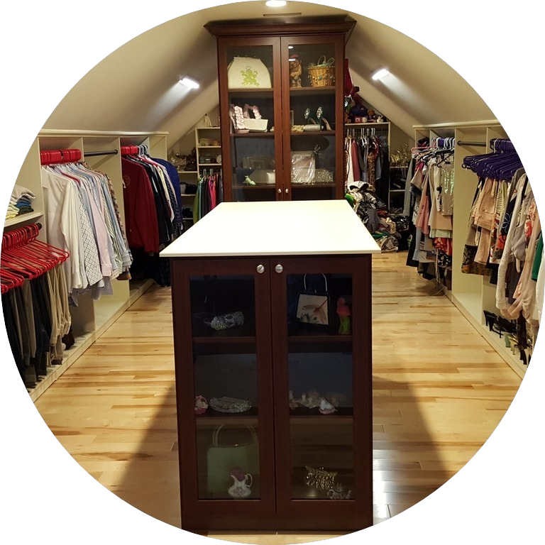 custom master closet with low ceiling over a garage