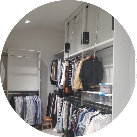 custom closets - whute custom closets with pull down 3rd level