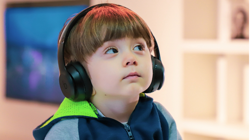 Young Person with disability listening to content