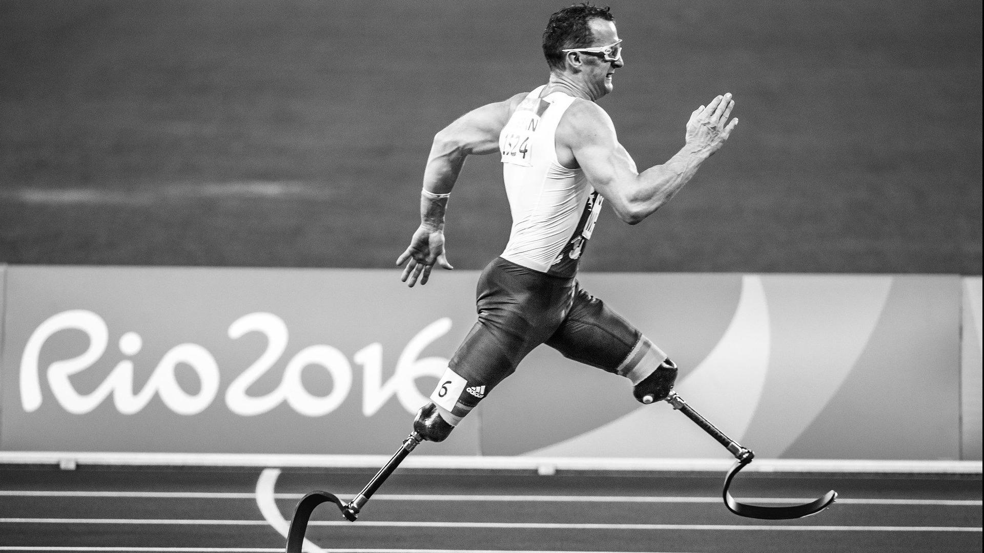 Runner with prosthetic legs