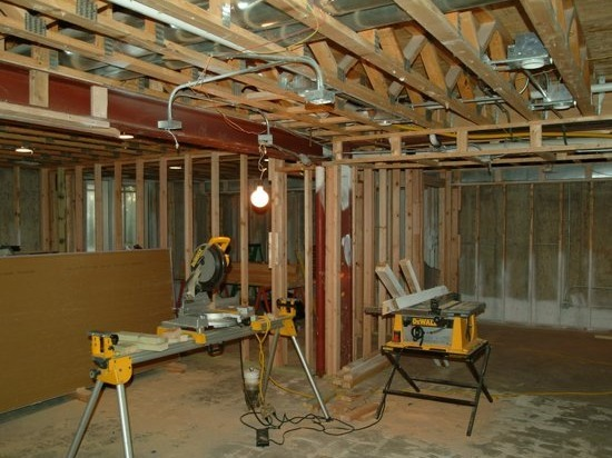Builders remodeling a kitchen in hoffman estates il with saws and wood.