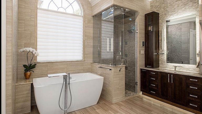 modern bathroom with tub, shower and vanity