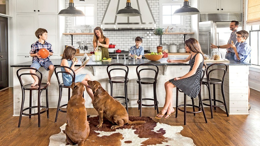 Family with dogs in their kitchen remodeler project