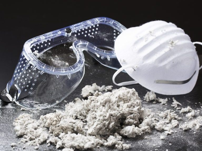 Safety goggles, mask and asbestos particles