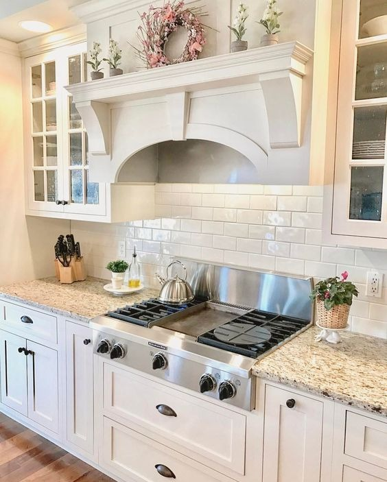white kitchen cabinets with a wood island