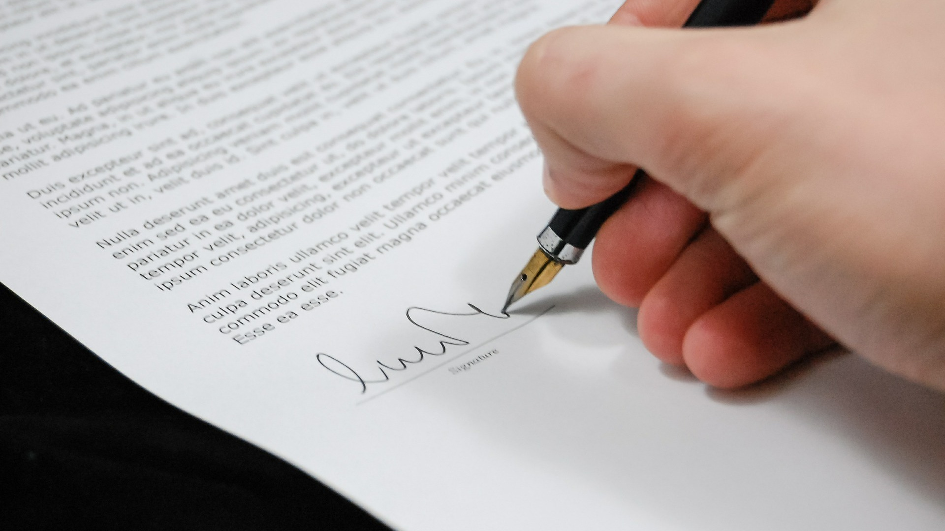 Hand signing paper