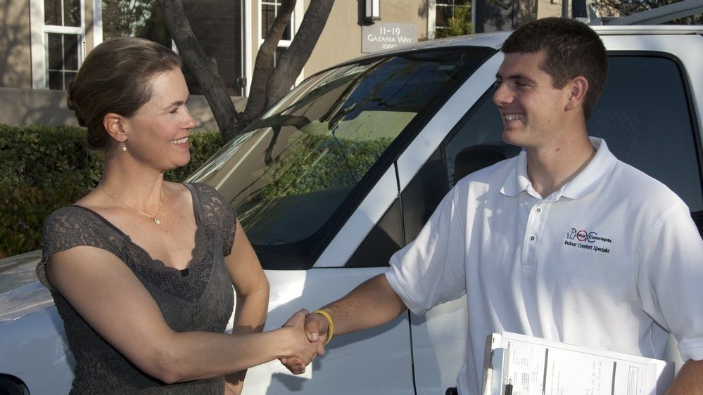 Employee of Air Concepts shaking hands with customer