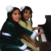 Young girls playing piano