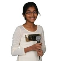 Young girl holding microphone