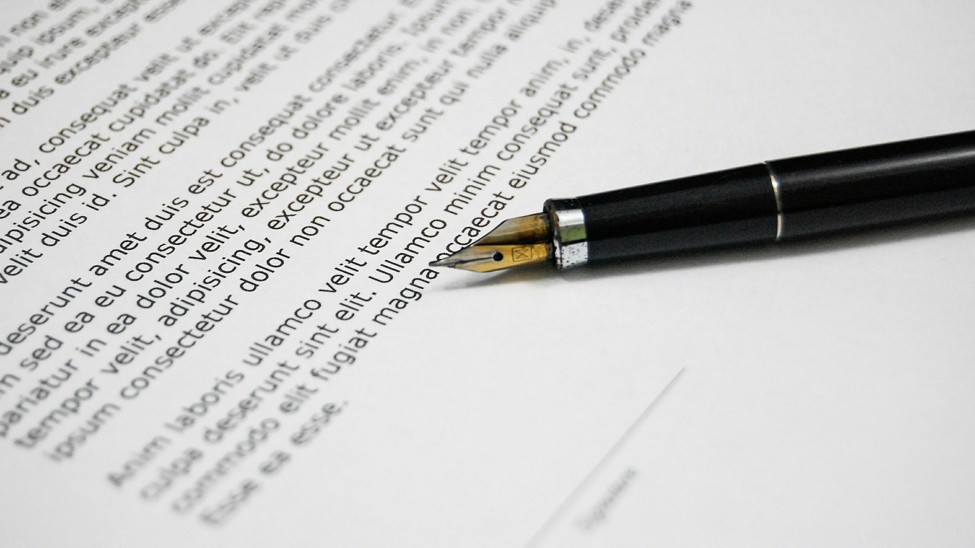 Pen resting on contract