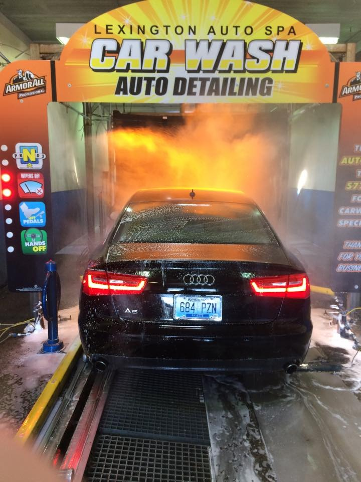 Car entering wash lane in lexington auto spa