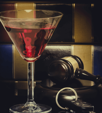 Cocktail in front of a Gavel and Keys