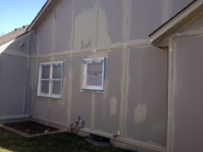 Greg Baker New Home Restoration Stages - Primer and Caulking Plastic Off Windows